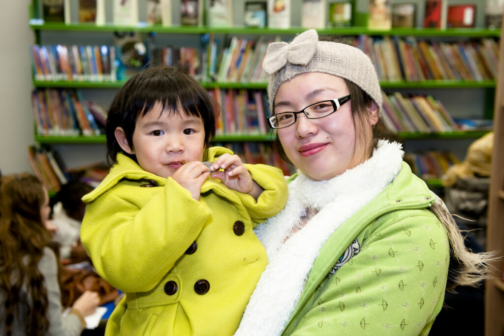Mother holding small child in the Redmond Community Centre